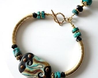 Lampwork Bangle Bracelet, Black and Turquoise, 14k gold filled, Swirls and Dots, Turquoise Heishe Beads, Swarovski Crystals, Beaded Bracelet