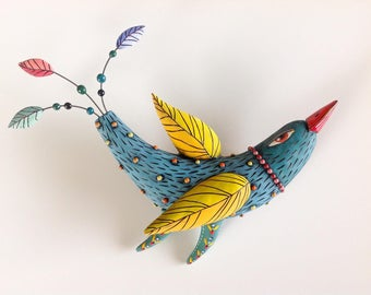 Turquoise Bird with Yellow  Wings