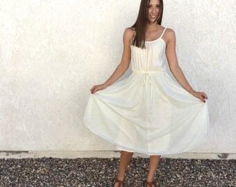 Vintage 70's sheer white metallic polka dot dress