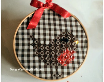 A kit for sewing a simple chicken scratch gingham cross stitch robin Christmas decoration in a hoop from WonkyGiraffe