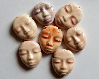 seven light colored faces