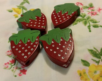 4 little wooden strawberries