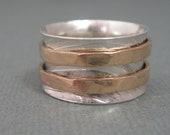 Mixed metal sterling silver spinner ring with 14kt gold filled spinners size 9