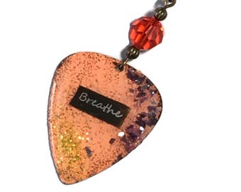 Guitar Pick Necklace BREATHE embedded in ORANGE with Orange Glass Bead Accents