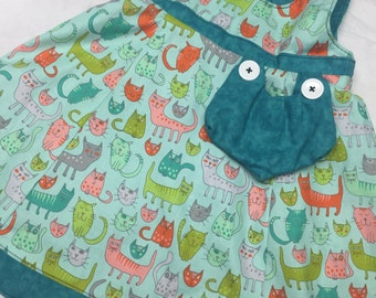 Reversible Cats jumper sizes 5-8 years