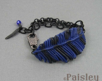 Blue Jay feather bracelet, blue black polymer clay feather on matte black chain with lobster clasp
