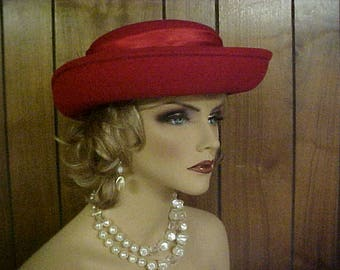"""SALE Red wool hat with red satin band and rosettes and wispy feather fits size 22-23 """""""