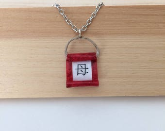 Mom in Japanese calligraphy on a red minimal necklace