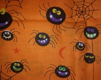1 yard of bright orange Halloween fabric with spiders and spiderweb 43 inches wide