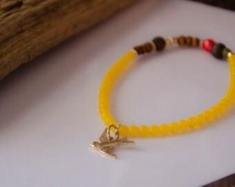 Bracelet liberté oiseau jaune