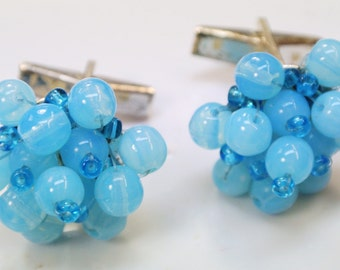 Pair of lovely vintage 1960s handmade blue glass bead cufflinks with silvercolor metal details