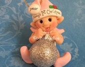 Pretty in pink elf with glitter ornament ball 1st Christmas ornament.