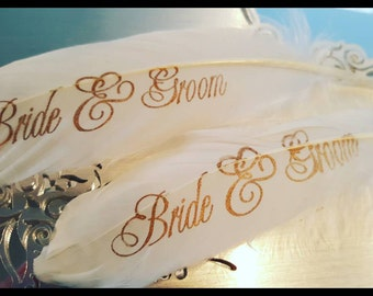 Small ostrich feather with Bride and Groom written in gold ink. Gatsby theme wedding. The great gatsby. Wedding decor. Decorations. Sweet 16