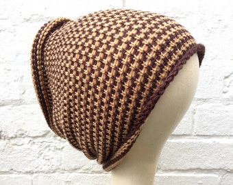 Brown tube hat, dreadlocks accessory, wide stripey hair wrap.