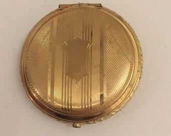 Vintage gold compact shield monogram