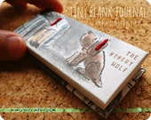 baxter & duk duk's tiny blank journal for big ideas - the hungry wolf