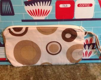 Mod retro wristlet.  Brown circle geometric shapes.  Zippered bag. Handmade wristlet.