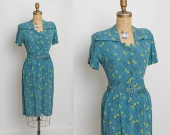 1940s vintage dress with belt | turquoise blue