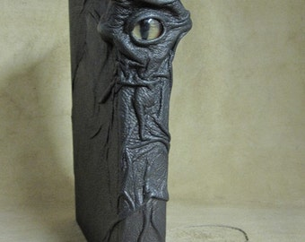 Grichels leather safe book - bronze with red and gold slit pupil shark eye
