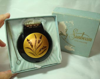 LADY SUNBEAM Vintage SHAVEMASTER Round Black and Gold Electric Shaver.