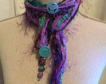 Skinny Whimsical Scarf Specialty Yarns Accented with Vintage Buttons....Purples and Teals