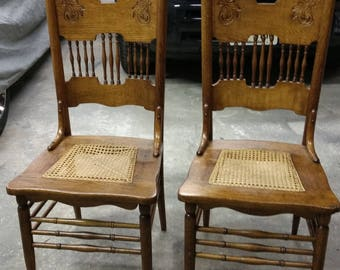 Two antique light oak cane bottom chairs