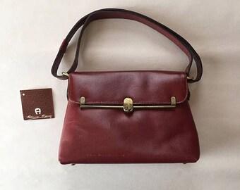 25% OFF SALE ... 1960s Etienne Aigner handbag | oxblood red leather doctor bag | brass lock | brass feet | designer purse