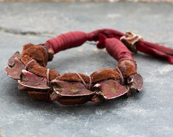 BONE BRAID ox blood metal snake vertebrae with leather Adjustable Bracelet by Jungle Tribe Couture