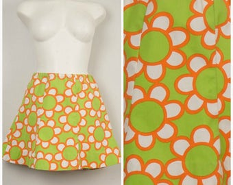 mod lime green and orange floral tennis skirt high waist bright colorful 60s 70s vintage A line short mini skater skirt small