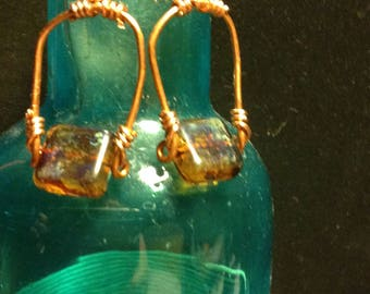 Copper stirrup earrings with Mottled brown and turquoise Czech beads and sterling hooks
