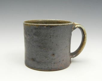 Wood/soda fired mug with slip and natural ash glaze