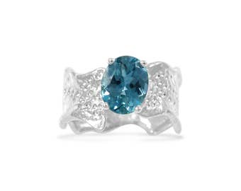 Oval Swiss Blue Topaz Sterling Silver Ripple with Organic Textured Band Colored Gemstone Ring Size 7 - 9.25