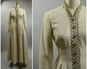 1970s Cleopatra Broumand Evening Dress Size Small Bengaline Metallic White and Gold with Darting Beaded Ball Buttons and Loop Metal Trim