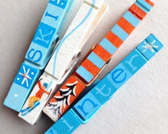winter skier clothespins snow covered trees ski magnetic clothespins orange and blue glitter snow winter
