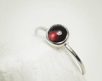 Silver ring with almandite garnet round