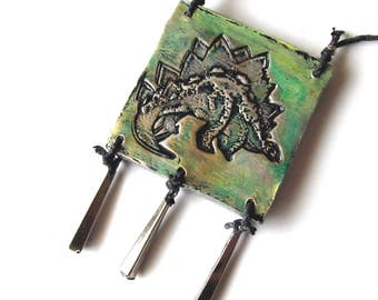 Pendant Necklace Dinosaur Stegosaurus Ceratosaurus Stamp in Clay Two-Sided Green Gold Silver Patina Vintage Upcycled Dangles on Hemp Cord