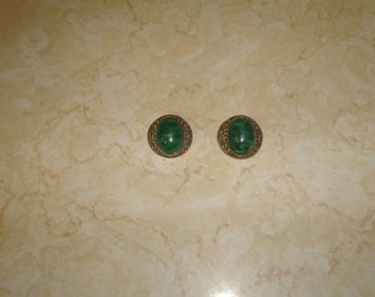 vintage clip on earrings goldtone filigree green swirl lucite