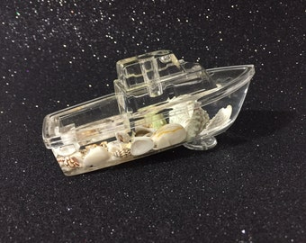 Vintage Nautical Inspired Acrylic Pen Holder And Paperweight In The Shape Of A Boat With Floating Seashells
