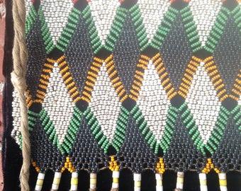 Mid century Kirdi African cameroon beaded skirt mounted on board