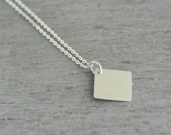 Delicate Sterling Silver Necklace made from a single sterling silver diamond shaped pendant in Sydney, Australia