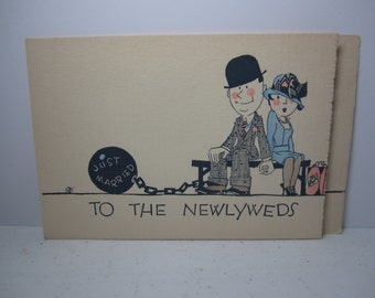 Colorful 1920's-30's unused  humorous buzza greeting for newlyweds man ball and chain next to flapper wife,black americana,artist stamp