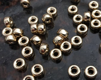 Sold by 10 beautiful 14 k gold filled gold  brite roundel 6 mm