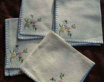 4 Vintage Hand Embroidered White Cotton Napkins in Very Good Condition with french knot flowers in a pastel color palette and blue edge trim