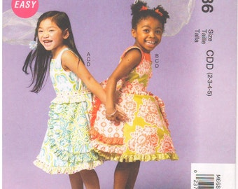 2013 - McCalls 6686 Sewing Pattern Girl Toddler Sizes 2/3/4/5 Easy Ruffles and Lace Treasured Collection Dress Belt Petticoat Ruffles