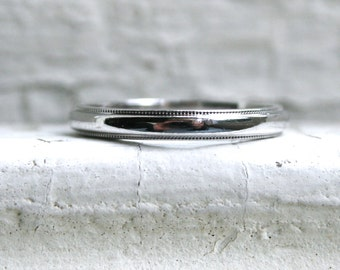 RESERVED - Vintage Tiffany & Co Platinum Wedding Band with Beaded Edge.