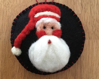 Santa Face Needle Felted On Black Felted Wool Fabric With Red Hat