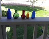 vintage collectible small bottles set of Five, one ruby red, two blue, one amber and one green.