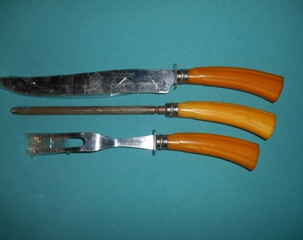 One (1), Vintage Meat/Poultry Carving Set, from Washington Forge, with Butterscotch Bakelite Handles.
