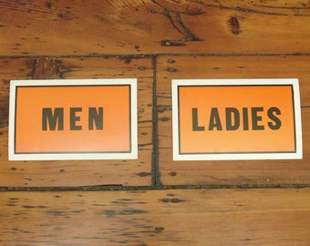 pair vintage cardboard men & ladies restrooms signs