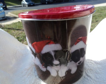 Large tin with lid and 3-D pictures of puppies